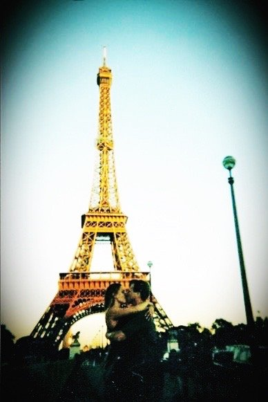 Kissing in front of the Eiffel Tower just before learning some valuable lessons on healthy communication in marriage