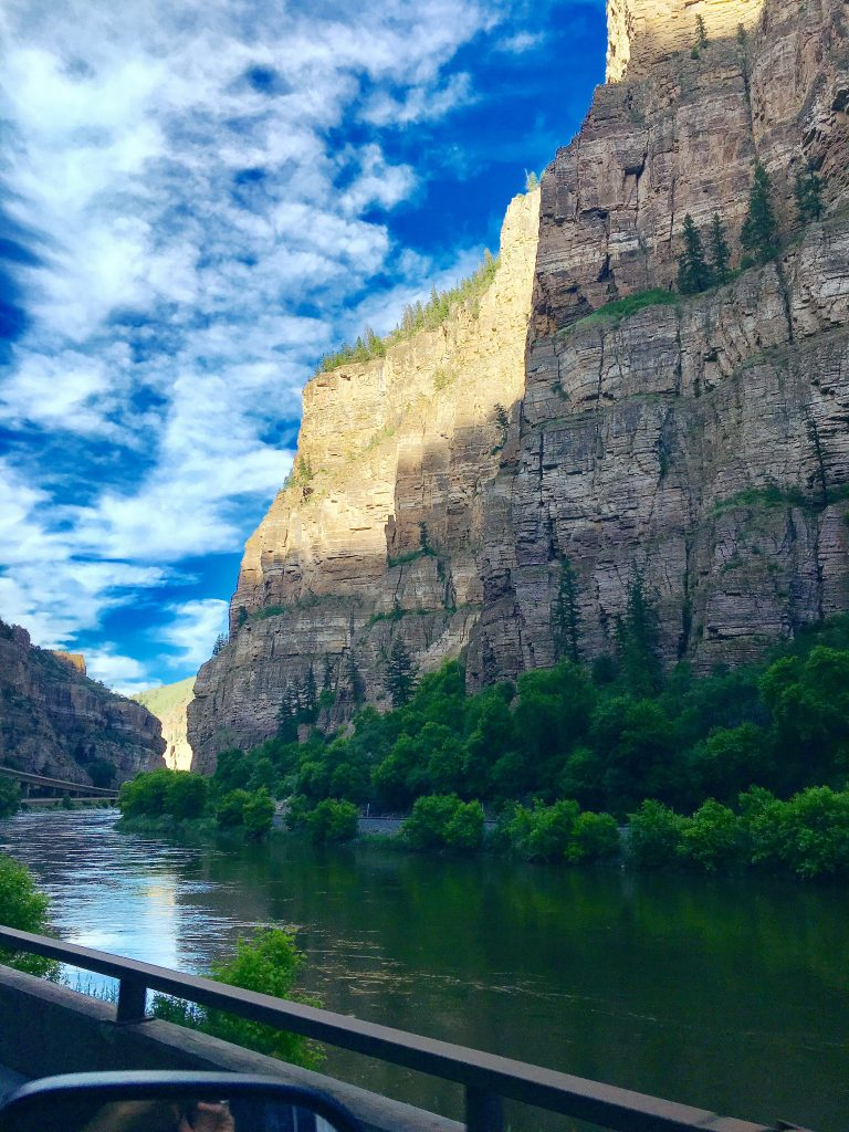 The Colorado Rockies are breathtaking, the cliffs of the gorge diving into the water below as the sun peeks through on our American Adventures