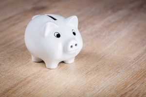 piggy bank for paying debt and pursuing dreams